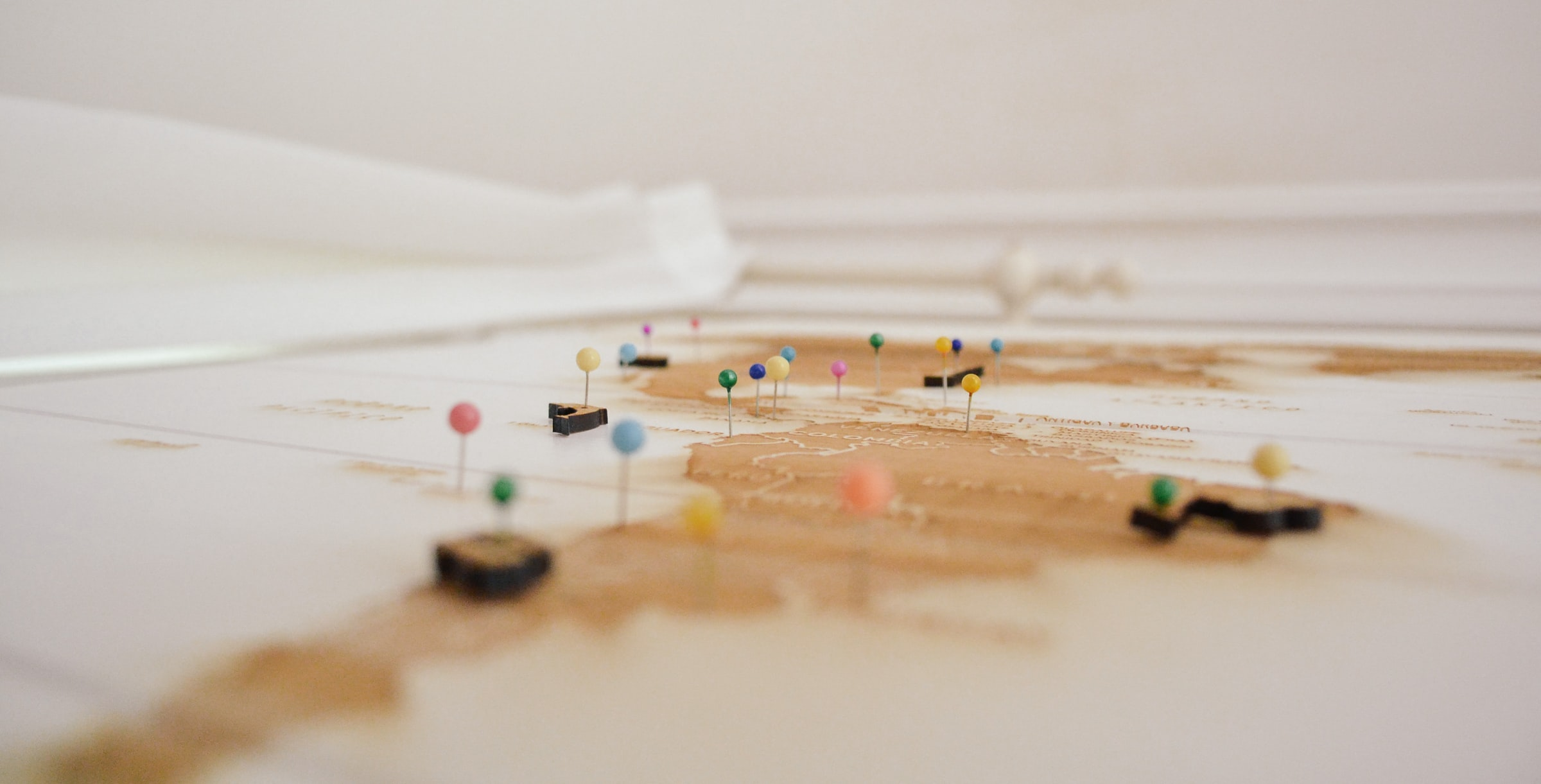 Colourful pins stuck into a map.
